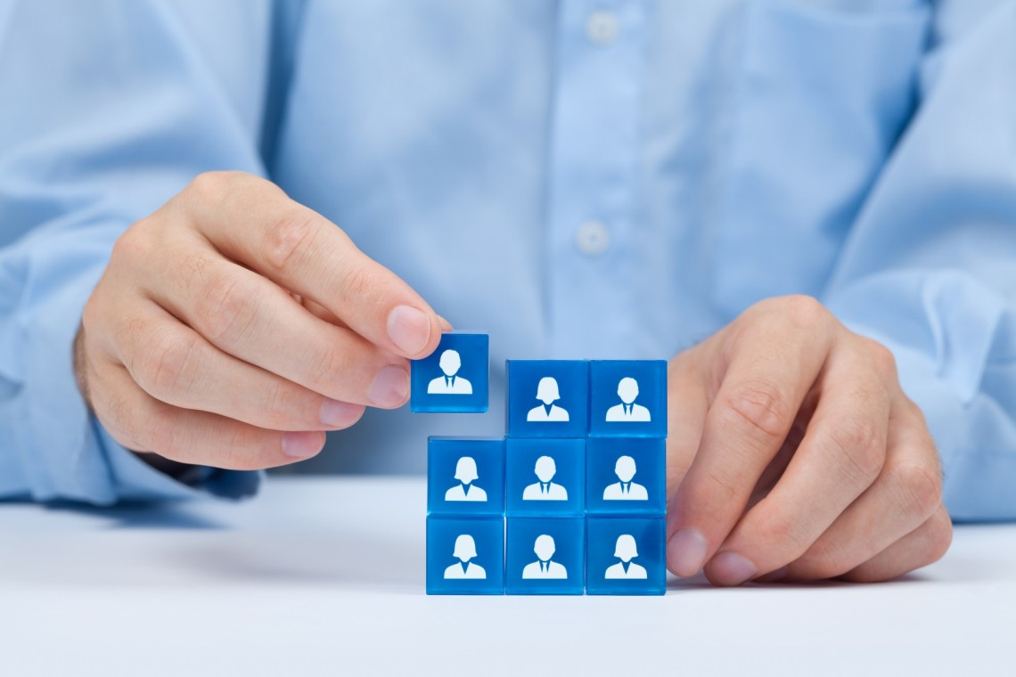 Human resources, social networking, assessment center concept, personal audit or CRM concept - recruiter complete team by one person. Employees are represented by blue glass cubes with icons.